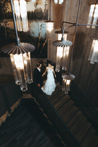 Sentry World Stevens Point Wedding Photographer Bride and Groom on Staircase