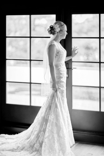 classic wisconsin bride lace dress bride photo by window at Rothschild pavillion