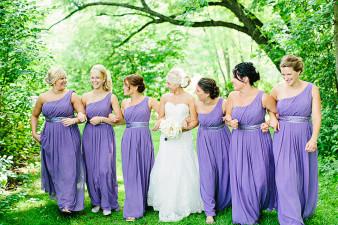 Wisconsin Bride with purple bridesmaids wedding dress