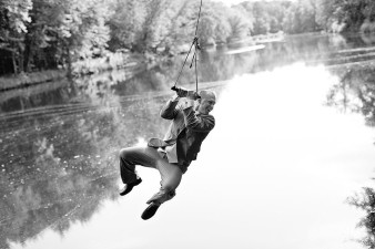 Fun Groom pictures on a swing over the rib river wisconsin