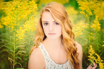 colby high school senior portraits taken in a yellow flower field photo